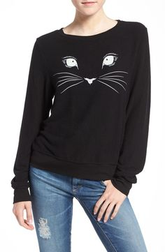 In love with this slouchy fleece pullover illuminated by a mysterious, midnight black feline's unwavering stare.