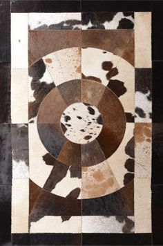 Premium.  Handcrafted Cowhide Leather Rug - For a Home as Unique as You.. $599.00, via Etsy.