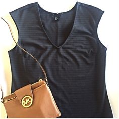 """H&M textured black top Great textured black top by H&M. The subtle textured stripes add some detail! Measures 18"""" from underarm to underarm and 27"""" long. Pullover styling. Poly/elastane. Excellent condition! H&M Tops"""