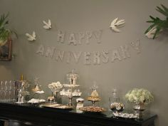 These glass glitter letters and white doves by Wendy Addison were the exact set displayed for my parents' 45th wedding anniversary. (Both available at http://www.tinseltrading.com)