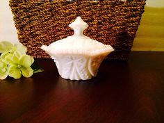 A personal favorite from my Etsy shop https://www.etsy.com/listing/222677725/vintage-milkglass-sugar-bowl-with-lid