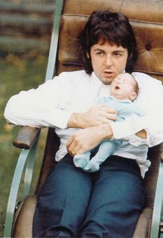 Paul and his baby photographed  by Linda McCartney