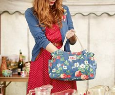 Wild strawberry blue cardigan   Mini dot red sleeveless dress   Wild strawberry matt-coated oilcloth day bag. From Cath Kidston's BEST IN SHOW: Spring 2013 #spring #fashion #accessories