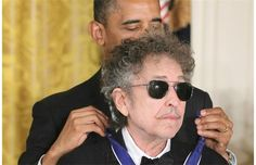 Bob Dylan is presented with a Presidential Medal of Freedom by U.S. President Barack Obama at the White House in Washington, DC on Tuesday, May 29, 2012.
