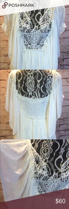 Free People beautiful lace and sheer blouse sz XS Knit fitted bodice overlayed with sheer flowing sleeves and lace accented with silver beads. So feminine, gorgeous! Size X-Small Free People Tops Blouses