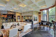 Open floor plan, wall of windows, black granite, wet bar, versace inspired interiors.