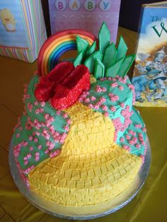 I got the idea for this cake from this website...Its one of the most fun cakes Ive ever made.  The slippers, rainbow and emerald city are all made from gum paste and the rest is butter cream.  I sprinkled the slippers with edible glitter from Michales...I think they made the cake.  Thanks for the inspiration Cake Central!