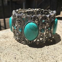 Turquoise Stone Bangle Bracelet This stunning silver and turquoise oval stone bangle bracelet in so beautiful! It's such an elegant statement piece and is just all around stunning! Brand new with tags! By T&J Designs T&J Designs Jewelry Bracelets