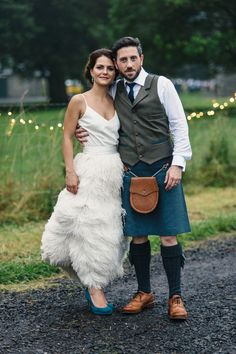 The bride wears an ostrich feather skirt and silk cami top by Charlie Brear for her Summer wedding at'The Byre at Inchyra' in Perthshire, Scotland.  Images by 'Photos by Zoe'.