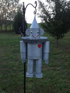 Tin Man bird feeder made out of cans.