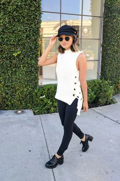Monday - The high-low design of this mock neck sleeveless sweater is perfect for covering the bum, while the side ties add flair. In an attempt to pull off the of-the-moment '90s revival look à la Bella Hadid, I accessorized with a baker boy hat, round sunnies and chunky lace-up shoes.