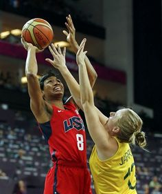 Angel McCoughtry of the U.S. is guarded by Australia's Rachel Jarry during their women's basketball semifinal match at the North Greenwich Arena.