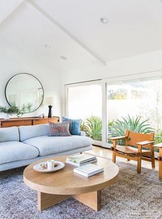 Minimalist Mid-Century living room with grey couch