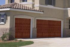 Fiberglass Garage Door Model 981 | Impression Collection® | This door features a classic vertical raised panel design with an oak wood grain pattern. | Learn more at overheaddoor.com