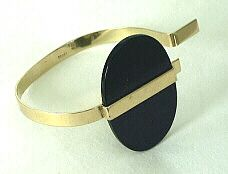 BETTY COOKE (gold and onyx bracelet).