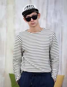 Be pumped for another bright summer day with this classic crew neck stripe shirt. Wear this paired with slim jeans or a baggy pair of pants. - Crew neck - Long sleeves - Stripe pattern - Seamed hemline - Colors: Navy, Red, Black, Gray