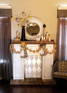 DIY Faux Fireplace repurposing cabinet doors.  I would put candles in the inset for ambiance instead of a light.