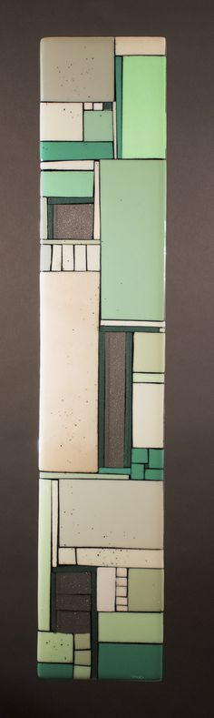 Lofts Green by Vicky Kokolski and Meg Branzetti. Old buildings given new life, opening windows that were not there before. Created by cutting neutral and soft green tones of art glass, outlined with powdered frit. Kiln fired to achieve the desired effect. Hung with picture frame wire in the back. Each is unique and will vary.