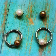Jewelry, ear, cartilage, rook, tragus, daith, hood, anti tragus, nostril, ring, pearls. $14.00, via Etsy.