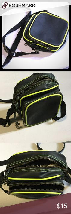 "Like New🏄 Cool neoprene organizer bag! Black & Neon Cross-body for work and play.  Such a cute and versatile bag.  Main compartment with inside zip pocket and matching key fob.  Extra front compartment. Long adjustable strap.  Great bronze metal hardware, clips and zippers.  Approx 7"" tall, 7.5"" wide, expands to 4"" deep. Unknown Bags"
