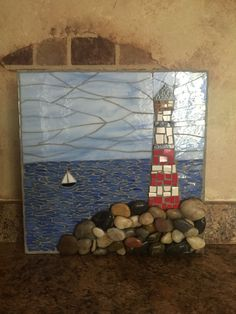 A personal favorite from my Etsy shop https://www.etsy.com/listing/464125888/lighthouse-art-lighthouse-mosaic-wall