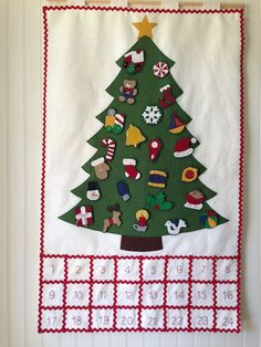 WOOL FELT CHRISTMAS ADVENT CALENDAR **PATTERN**  A delightful combination of wool felt, embroidery, rick rack, and beads to help your family