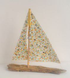First sailboat in a while. This little ray of sunshine is Buttercup, made from driftwood collected from the Isle of Mull on a bitter windswept day when spring seemed far away - but here she is, at last wink emoticon  She measures 10ins x 10ins and her sails are dotted with tiny gold and silver vintage watch parts that sparkle in the sun. I think they mark time passing, but I'm never exactly sure...