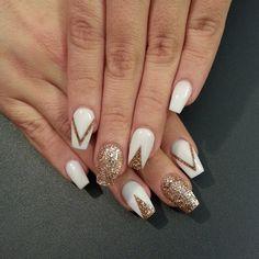 White and gold glitter nail art design in v-shapes and white base polish.