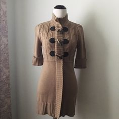 Brand new Takeout tan sweater top Never been worn. Great quality! Beautiful tan color with wedge buttons. Zips all the way down with the button at the top of the neck. Takeout Tops
