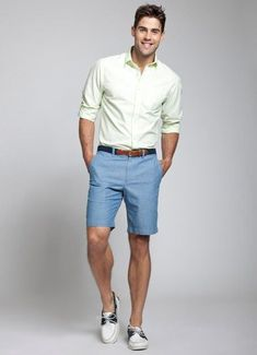 Shop this look on Lookastic:  https://lookastic.com/men/looks/green-yellow-long-sleeve-shirt-blue-shorts-white-and-black-boat-shoes-navy-belt/11935  — Green-Yellow Long Sleeve Shirt  — Navy Canvas Belt  — Blue Shorts  — White and Black Leather Boat Shoes