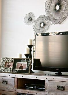 The Yellow Cape Cod: decorating around a flatscreen tv. rustic tv cabinet. wire art.