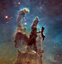 """Back in 1995, the Hubble telescope took an absolutely breathtaking photo of stars being formed that's now known as """"Pillars of Creation."""" And now, 20 years later, NASA has released a couple new images of the same star formation that was taken by a new and improved Hubble last year. Absolutely gorgeous."""