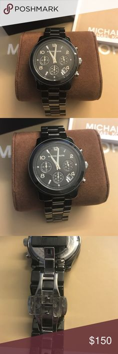 Michael Kors ceramic watch Michael Kors dark gunmetal/almost black ceramic water with three chronograph dial. Battery needs to be replaced. Comes in MK box and watch pillow w watch manual. Worn barely once - there is still plastic on inside (as pictured). Sized to wrist 6 inches. Watch was close to $400 but can't find exact price. Michael Kors Accessories Watches