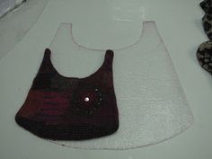 Andrea's blog steps felt purse. Resist size to felted finish.