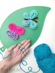 """Finger Knitting Projects - learn to finger knitting AND make these super cute Finger Knitted Butterflies. We love to finger knit in our house and the kids have long learned how to finger knit. Now we are constantly trying to come up with project ideas for finger knitting and what to make with all those """"finger knitted sausages""""!!!"""