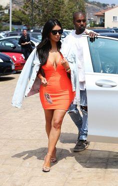 On Kim Kardashian West: Givenchy 7002/S Sunglasses ($295); Levi's The Trucker Jacket ($70); Mark Wong dress; Tom Ford Strappy Sandals ($990).