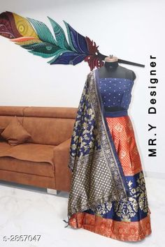 Lehengas Elegant Women's Lehenga Fabric: Lehenga - Jacquard Choli - Taffeta Silk Dupatta - Banarasi Silk  Size: Lehenga (Waist Size) - Up To 36 in Choli - 0.80 Mtr Dupatta - 2.2 Mtr  Length: Lehenga - Up To 40 in Flair: Lehenga - 2.8 Mtr Type: Lehenga - Semi - Stitched Choli - Un - Stitched Description: It Has 1 Piece Of Lehenga 1 Piece Of Choli & 1 Piece Of Dupatta Work: Lehenga - Jacquard Work Choli - Printed Dupatta - Jacquard Work Country of Origin: India Sizes Available: Un Stitched, Free Size, Semi Stitched   Catalog Rating: ★4.4 (519)  Catalog Name: Hiba Elegant Women's Lehengas Vol 13 CatalogID_389506 C74-SC1005 Code: 658-2867047-4722