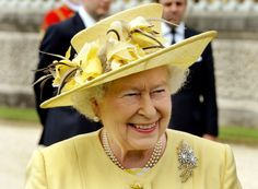 """royalhats:  Queen Elizabeth attended a garden party for the """"Not Forgotten"""" Association (NFA), Buckingham Palace, June 26, 2014.  The Queen wore a dress and coat by Angela Kelly, hat by Rachel Trevor Morgan and the Australian Wattle brooch of diamonds."""