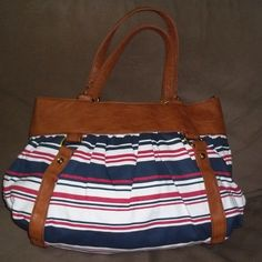 "Handbag Multi colored canvas bag with faux leather trim. Bag length is 18"" strap drop is 10"" and height is 12"". It is practically new no stains or tears clean inside and out. Very roomy Call It Spring Bags"