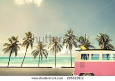 Vintage car in the beach with a surfboard on the roof