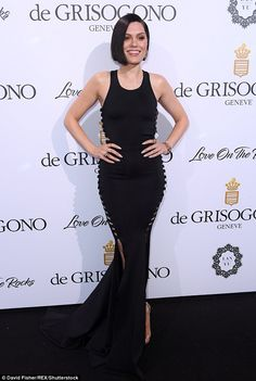 Sizzling: British beauty Jessie J, 29, sizzled on the black carpet in her skintight ensemble which featured daring cutout slits down either side of her torso