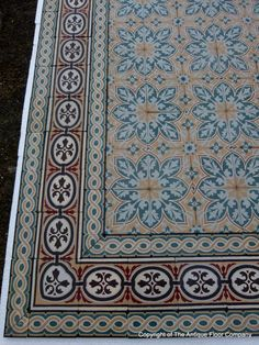 An 11.5m2+ vegetal themed antique French ceramic floor with triple borders - The Antique Floor Company