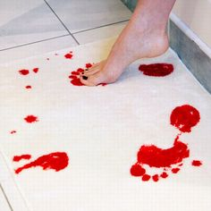 Bloody bathmat!  so creepy yet awesome...  from Killer Home Decor