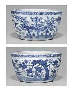A RARE BLUE AND WHITE JARDINIERE   LATE MING DYNASTY, 16TH-17TH CENTURY   Thickly potted with somewhat bulbous sides that taper towards the base and are decorated with a continuous frieze of 'The Three Friends,' prunus, pine and bamboo, with birds in flight between. There is a band of classic scroll on the sides of the molded rim, and foliate sprays on the top.  13 1/8 in. (33.3 cm.) diam., Japanese wood box