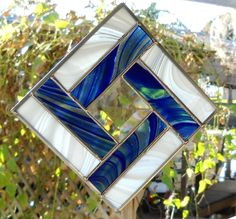 Stained Glass Quilt Square Suncatcher in Wispy Blue and White. $20.00, via Etsy.