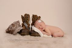 newborn girl with fathers military boots dog tags