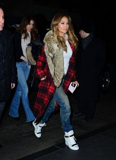 Style Inspiration Straight From Jennifer Lopez's Movie-Tour Looks: For a sporty vibe, Jennifer paired two unlikely pieces: a plaid fur-trim Michael Kors coat with Giuseppe Zanotti wedge sneakers. Thanks to this ensemble, we now love the idea of Buffalo plaids with baggy jeans, a basic white tee, and and crisp white sneakers, especially for the weekend.