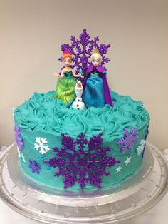 Elsa, Anna and Olaf snowflake cake in purple and turquoise blue.