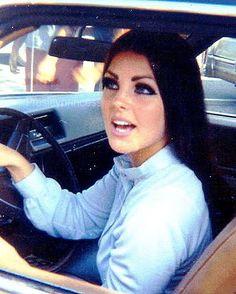 Priscilla Presley stops to greet fans,1968.