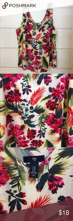 NWT Gap XL Floral Tank! NWT Gap XL Floral Tank! Great condition! Tag is still attached but has been torn in half. Pretty floral fabric! Great top for spring and summer! Bundle with my other listings and save! GAP Tops Tank Tops